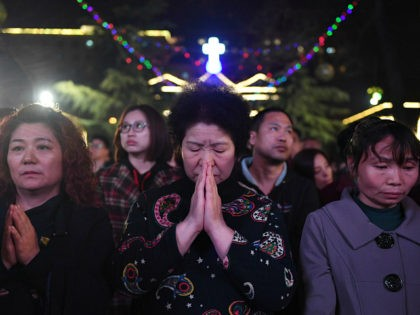 Chinese Catholics attend a mass on Holy Saturday, part of Easter celebrations at Beijing's government sanctioned South Cathedral on March 31, 2018. Chinese Catholics are taking part in Easter celebrations as China and the Vatican continue talks on a historic agreement on the appointment of bishops in China. / AFP …
