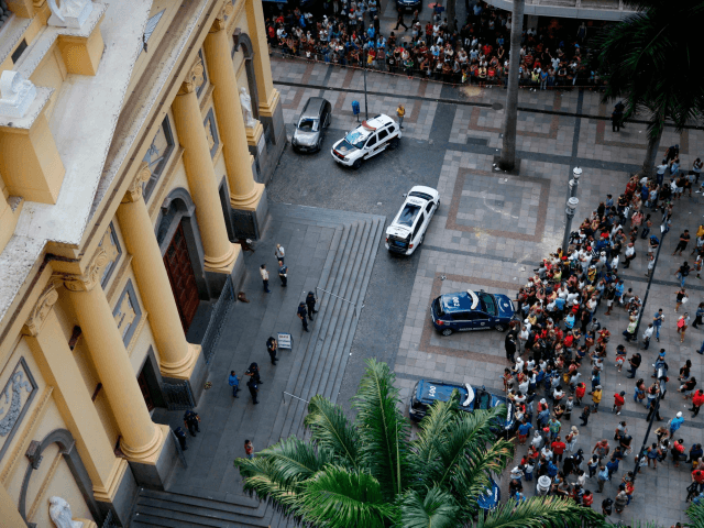 Aerial view showing people gathering outside the Cathedral of Campinas, 90 km northwest of Sao Paulo, Brazil, on December 11, 2018, after a man opened fire during mass and killed at least four people before committing suicide. - Paramedics told media the man fired a revolver and a .38-caliber pistol …