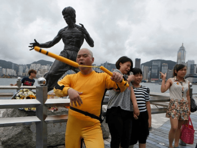 A Japanese fan dresses as the late Hong Kong Kung Fu star Bruce Lee and shows his skill of Nunchaku in front of the Lee's bronze statue in Hong Kong Saturday, July 20, 2013 to commemorate the 40th anniversary of his death. New York's ban on nunchucks was ruled unconstitutional …