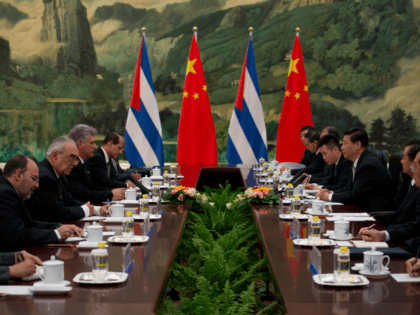 China's President Xi Jinping (centre R) attends a meeting with Cuba's First Vice President of the Council of State Miguel Diaz-Canel (centre L) at the Great Hall of the People on June 18, 2013. Diaz-Canel is on an official visit to China from June 17 to 19. AFP PHOTO / …