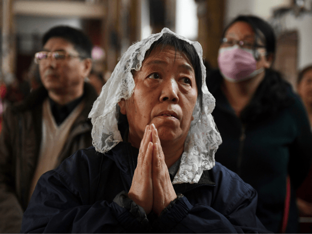 Catholic worshippers attend a mass on Holy Thursday, ahead of Easter celebrations, at Beijing's government-sanctioned South Cathedral in Beijing on March 29, 2018. A historic agreement between the Vatican and Beijing on the appointment of bishops in China could be signed as early as March 31, a Chinese government-approved bishop …