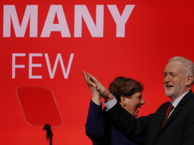 BRIGHTON, ENGLAND - SEPTEMBER 25: Labour Leader Jeremy Corbyn High Fives Shadow First Secretary of State Emily Thornberry after her key note speach in the main hall during day two of the Labour Party Conference on September 25, 2017 in Brighton, England. (Photo by Dan Kitwood/Getty Images)