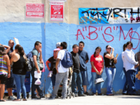 This August 15, 2012 file photo shows young people waiting in line to enter the Coalition for Humane Immigrant Rights of Los Angeles (CHIRLA) office in California, on the first day of the Deferred Action for Childhood Arrivals (DACA) program. Democratic US President Barack Obama failed on his promise of …