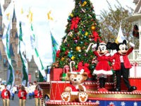 LAKE BUENA VISTA, FL - DECEMBER 01: In this handout photo provided by Disney, Mickey and Minnie Mouse wave to the crowd while taping the 'Disney Parks Christmas Day Parade' TV special in the Magic Kingdom park at Walt Disney World on December 1,2012 in Lake Buena Vista, Florida. The …