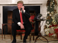 U.S. President Donald Trump and first lady Melania Trump as they track Santa Claus's movements with the North American Aerospace Defense Command (NORAD) Santa Tracker on Christmas Eve at the White House December 24, 2018 in Washington, DC. This is the 63rd straight year that NORAD has publicly tracked Santa's …
