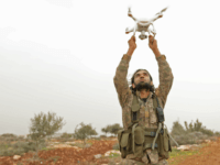 A Turkish-backed Syrian rebel fighter uses a drone at a monitoring point near the Syrian village of Qilah, in the southwestern edge of the Afrin region close to the border with Turkey, on January 22, 2018. Turkish forces began shelling the YPG enclave of Afrin from frontier Hatay province, according …