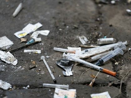 WALSALL, ENGLAND - DECEMBER 06: Syringes and paraphernalia used by drug users litter an alley way in Walsall Town Centre on December 06, 2018 in Walsall, England. There were 268,390 adults in contact with drug and alcohol services in 2017 to 2018, according to a recent government report, which is …