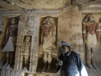 Said Abdel Aal, an Egyptian archaelogical labourer, stands in a newly-discovered tomb at the Saqqara necropolis, 30 kilometres south of the Egyptian capital Cairo, on December 15, 2018, belonging to the high priest 'Wahtye' who served during the fifth dynasty reign of King Neferirkare (between 2500-2300 BC). - The well-preserved …