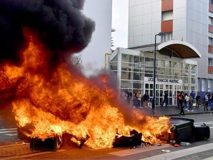 TOPSHOT - High school students burn a barricade in front of the Francois Mauriac high school during a demonstration against French government Education reforms on December 4, 2018 in Bordeaux, southwestern France. (Photo by NICOLAS TUCAT / AFP) (Photo credit should read NICOLAS TUCAT/AFP/Getty Images)