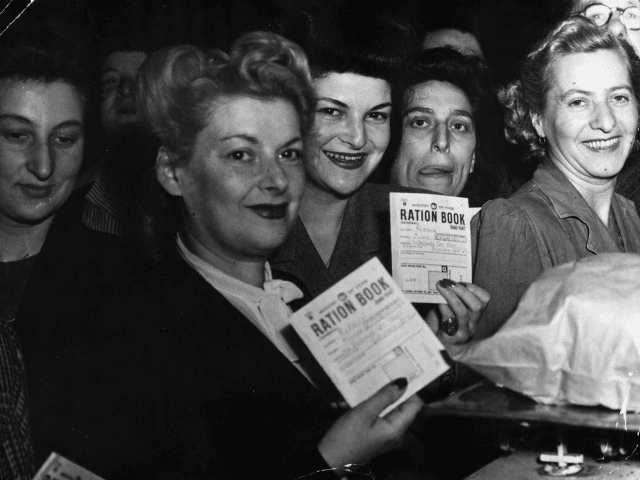 21st June 1946: Hungry housewives bring their ration books to London's Petticoat Lane Market during World War II on the first day of bread rationing. (Photo by Eric Harlow/Keystone/Getty Images)