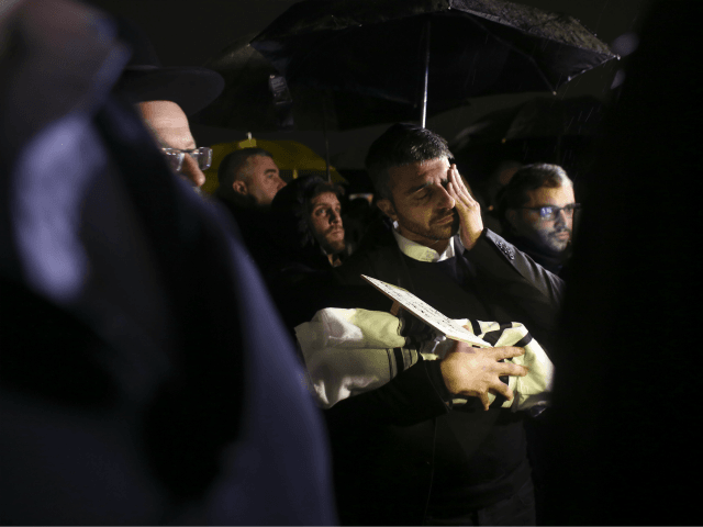 People attend the funeral of a baby who died after being prematurely delivered after her mother Shira Ish-Ran was wounded in a shooting attack near Ofra settlement in the West Bank last Sunday, in Jerusalem, Wednesday, Dec. 12, 2018. (AP Photo/Heidi Levine)
