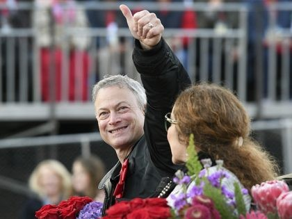 Grand Marshal Gary Sinise gives a thumbs up to the crowd at the 129th Rose Parade in Pasadena, Calif., Monday, Jan. 1, 2018. (AP Photo/Michael Owen Baker)