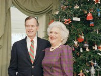 Vice President George H.W. Bush poses with wife Barbara by the White House Christmas tree, Dec., 1988. (AP Photo)