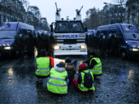 France: Anti-Macron Protesters Pushed Off Street by Water Cannon, Told to Remove Yellow Vests