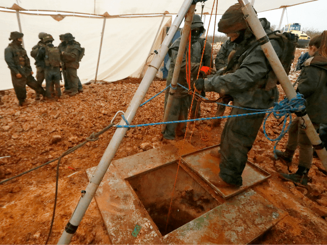 A picture taken on December 19, 2018 during a guided tour by the Israeli army shows an Israeli soldier operating a pulley while standing outside an entry point made by the army to intercept a tunnel which reportedly connects between Lebanon and Israel, near the border near the northern Israeli …