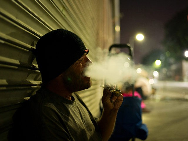 D. J. Meek, a 40-year-old homeless drug addict, smokes crystal meth Friday, Sept. 8, 2017, in the Skid Row area of downtown Los Angeles. Meeks' veins are collapsed due to chronic use of heroin. He said talking to himself makes him unemployable. The latest nationwide homeless count shows that 4 …