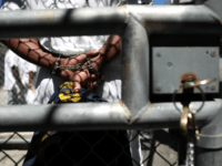 A condemned inmate stands with handcuffs on as he preapres to be released from the exercise yard back to his cell at San Quentin State Prison's death row on August 15, 2016 in San Quentin, California. San Quentin State Prison opened in 1852 and is California's oldest penitentiary. The facility …