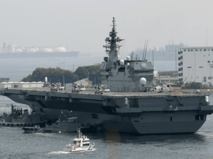 Japan's Maritime Self Defense Forces helicopter carrier Izumo sails out its Yokosuka Base in Kanagawa prefecture on May 1, 2017. Japan on May 1 dispatched its biggest warship since World War II to protect a US supply ship, one of the country's military roles expanded under Prime Minister Shinzo Abe, …