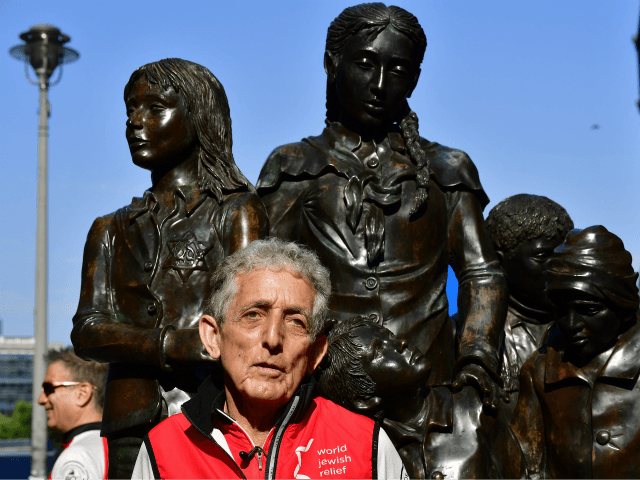 Israeli Paul Alexander poses at rail station 'Friedrichstrasse' before cycling from Berlin to London to commemorate the 80th anniversary of the 'Kindertransport' wartime rescue effort on June 17, 2018. - Paul Alexander was a 19-month-old toddler when his mother handed him to a volunteer nurse on a train leaving Nazi …