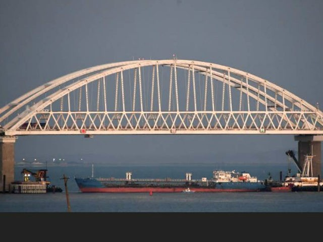 A ship under the the Kerch bridge blocks the passage to the Kerch Strait near Kerch, Crimea, Sunday, Nov. 25, 2018. Russia and Ukraine traded accusations over an incident at sea Sunday near the disputed Crimean Peninsula, increasing tensions between both countries and prompting Moscow to block passage through the …