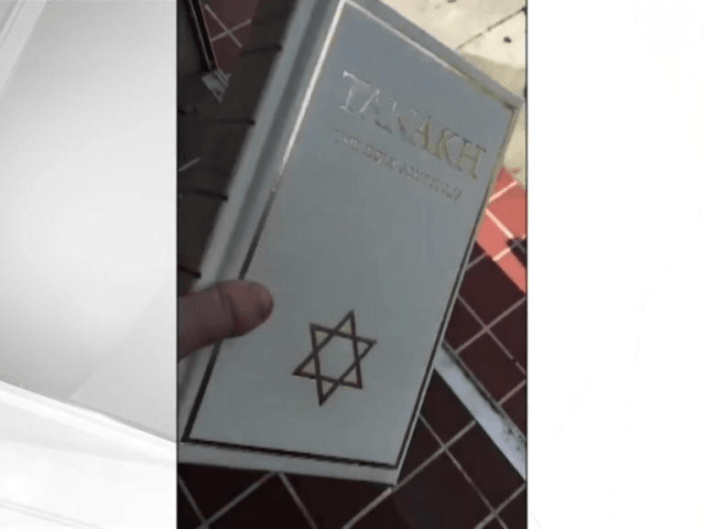 Miami police officer suspended after video emerges of him tossing Jewish bible
