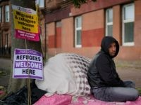 GLASGOW, SCOTLAND - AUGUST 01: Afghan refugee Rahman Sahah (L) , 32 and Mirwais Ahmadzai, 27, start their hunger strike outside the H.M. Government Home Office on August 1, 2018 in Glasgow, Scotland. Both men have been refused asylum in the UK and are currently tenants of social housing provider …