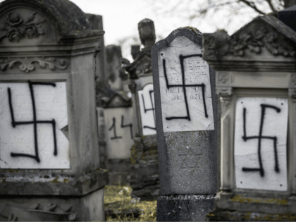 Jewish tombstones are seen desecrated with swastikas in the Herrlisheim Jewish cemetery, north of Strasbourg, eastern France, Thursday, Dec. 13, 2018. Dozens of tombs were defaced were discovered Tuesday. (AP Photo/Jean-Francois Badias)