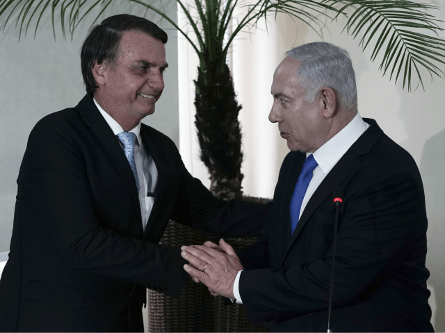 Brazil's President-elect Jair Bolsonaro, left, and Israel's Prime Minister Benjamin Netanyahu shake hands during a joint statement at the military base Fort Copacabana, in Rio de Janeiro, Brazil, Friday, Dec. 28, 2018. Despite earlier reports, Netanyahu plans to attend the inauguration of Bolsonaro on Tuesday, Jan. 1, 2019 in Brasilia. …