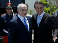 Israel's Prime Minister Benjamin Netanyahu (L) is welcomed by Brazil's President-elect Jair Bolsonaro at the Copacabana fort in Rio de Janeiro, Brazil, on December 28, 2018. - Netanyahu hailed what he said would be a 'new era' in ties with 'great power' Brazil ahead of a meeting with the Latin …