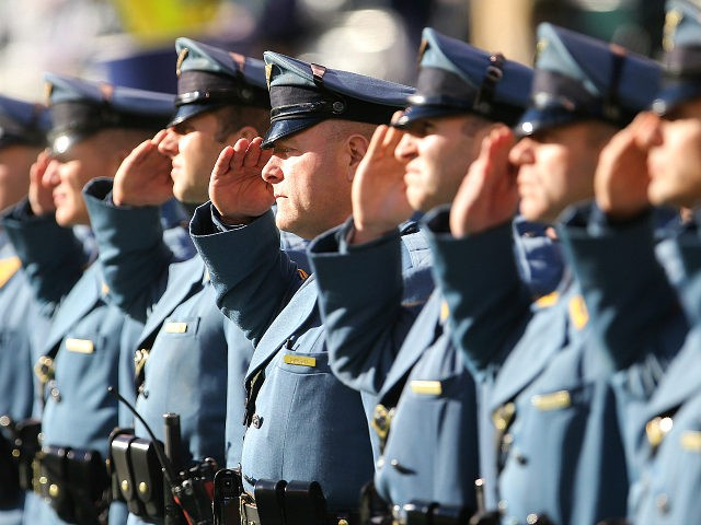 https://media.breitbart.com/media/2018/12/new-jersey-state-police-troopers-salute-getty-18-getty-640x480.jpg