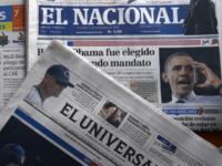 Newspapers headline US President Barack Obama's reelection on November 7, 2012 in Caracas. AFP PHOTO/JUAN BARRETO (Photo credit should read JUAN BARRETO/AFP/Getty Images)