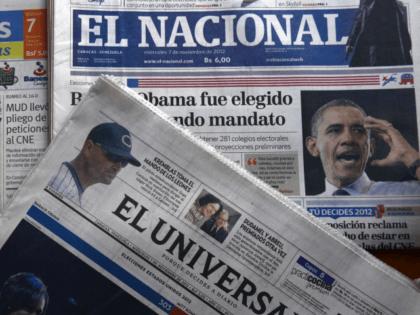 Newspapers headline US President Barack Obama's reelection on November 7, 2012 in Caracas. AFP PHOTO/JUAN BARRETO (Photo credit should read JUAN BARRETO/AFP/Getty Images)