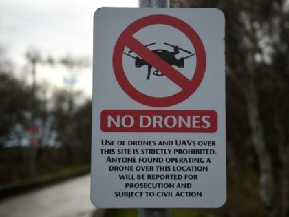 A 'No Drones' sign alerting members of the public that the use of drones or unmanned aerial vehicles (UAV) is prohibited, is pictured outside Manchester United's Carrington Training complex in Manchester, north west England on December 20, 2018. - London Gatwick Airport was forced to suspend all flights Thursday due …