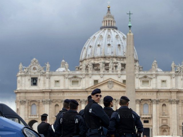 Italian police stand in front of St. Peter's basilica in the Vatican on March 27, 2015. AFP PHOTO / FILIPPO MONTEFORTE (Photo credit should read FILIPPO MONTEFORTE/AFP/Getty Images)