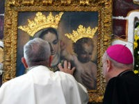 Pope Francis touches an icon of Mary and Jesus during a commemoration ceremony for the 25th anniversary of the death of Don Tonino Bello in Alessano, southern Italy on April 20, 2018. (Photo by Vincenzo PINTO / AFP) (Photo credit should read VINCENZO PINTO/AFP/Getty Images)