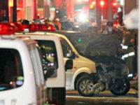 Police inspect a car whose driver rammed his vehicle into crowds on Takeshita street in Tokyo early January 1, 2019. - Nine people were hurt, one seriously, when a man deliberately ploughed his car into crowds celebrating New Year's Eve along a famous Tokyo street, police and media said on …