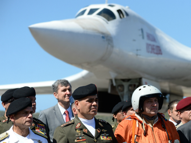 Venezuelan Defence Minister Vladimir Padrino (2-L) is pictured after the arrival of two Russian Tupolev Tu-160 strategic long-range heavy supersonic bomber aircrafts at Maiquetia International Airport, just north of Caracas, on December 10, 2018. - Venezuela and Russia will hold joint air force exercises for the defence of the South …