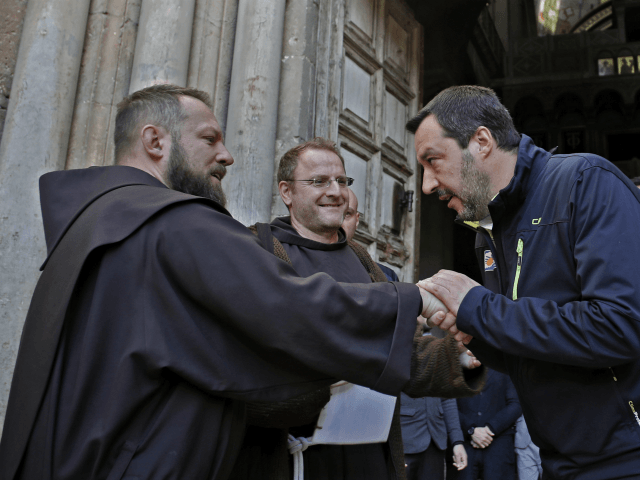 Italy's far-right Interior Minister and Deputy Prime Minister Matteo Salvini shakes hands with Franciscan friars at the end of a visit to the Church of the Holy Sepulchre in the Old City of Jerusalem, on December 12, 2018. (Photo by THOMAS COEX / AFP) (Photo credit should read THOMAS COEX/AFP/Getty …