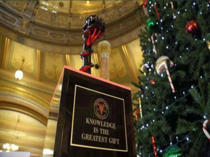 """A satanic group has added its own statue, """"Snaketivity,"""" to a series of displays in the government building of the US state of Illinois to mark the festive season."""