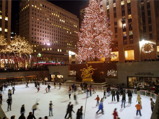 Ice skaters glide around the rink beneath Christmas lights at Rockeller Plaza December 4, 2001 in New York City. New York is in full holiday swing as the city attempts to recover from the September 11th World Trade Center attacks. (Photo by Mario Tama/Getty Images)