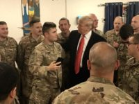 A United States Army soldier told President Trump during his visit on Christmas evening to the Al Asad Airbase in Iraq that he reenlisted in the military because of him.
