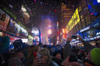 Reevelers cheers under falling confetti at the stroke of midnight during the New Year's Eve celebrations in Times Square, Wednesday, Jan. 1, 2014, in New York. (AP Photo/John Minchillo)