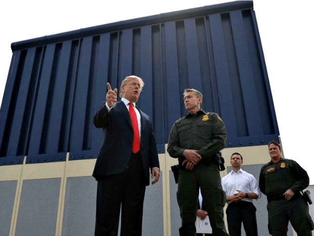 President Donald Trump speaks during a tour to review border wall prototypes, March 13, 2018, in San Diego, as Rodney Scott, the Border Patrol's San Diego sector chief, listens.
