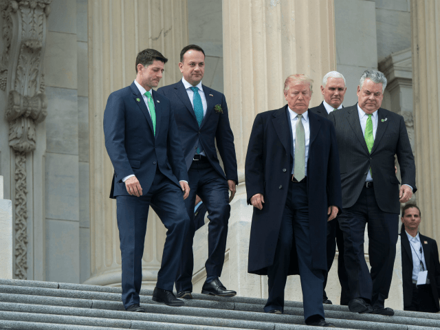 House Speaker Paul Ryan, Republican of Wisconsin, Ireland's Prime Minister Leo Varadkar, US President Donald Trump, Representative Peter King, Republican of New York, and Vice President Mike Pence, leave after the annual Friends of Ireland luncheon at the US Capitol in Washington, DC, March 15, 2018. / AFP PHOTO / …