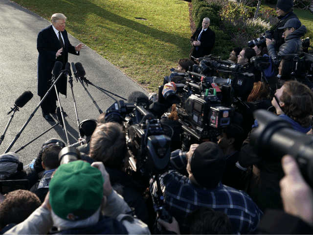 U.S. President Donald Trump speaks to members of the media prior to his departure from the White House November 20, 2018 in Washington, DC. President Trump is traveling to his Mar-a-Lago resort in Palm Beach, Florida, for the Thanksgiving holiday. (Photo by Alex Wong/Getty Images)