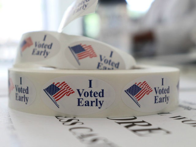 In this May 21, 2018, photo, a roll of stickers awaiting distribution to early voters sits on a table at the check-in station at the Pulaski County Courthouse Annex in Little Rock, Ark. Voters in four states are casting ballots Tuesday as the 2018 midterm elections take shape. Primaries are …
