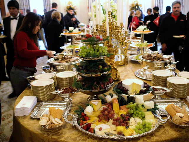 Members of the press try the food that will be served at the White House holiday parties during a press preview of the White House holiday decorations November 29, 2007 in Washington, DC. 'Holiday in the National Parks' was the theme of the White House 2007 holiday decorations. (Photo by …
