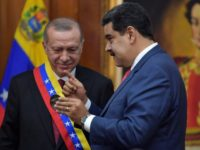 Venezuelan President Nicolas Maduro decorates Turkish President Recep Tayyip Erdogan with the Order of the Liberator in Caracas