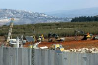 Israeli soldiers deploy excavators alongside the border wall with Lebanon on December 5, 2018, after the army announced it had discovered Hezbollah infiltration tunnels passing under it
