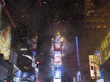 The ball drops to enter in the new year during New Year's Eve celebrations in Times Square on January 1, 2018 in New York -- the plaza is an iconic must-see for tourists